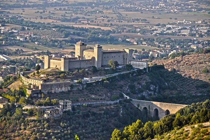 Spoleto Castle in Umbria. The region includes Lake Trasimeno  and the capital is Perugia. Umbria is known for its landscapes, traditions, history and culture.